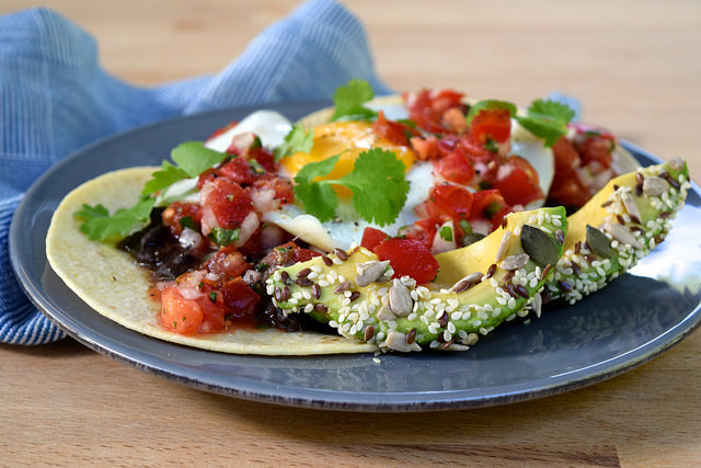 Healthy Huevos Rancheros with Seeded Avocado | www.rachelphipps.com @rachelphipps