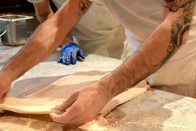 Rolling Pizza Dough at Firezza, Soho   www.rachelphipps.com @rachelphipps