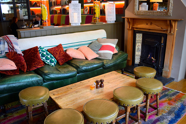 Seats by the fire at The Royal Oak, Twickenham | www.rachelphipps.com @rachelphipps